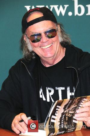 Neil Young - Neil Young signs copies of his book 'Special Deluxe: A Memoir of Life & Cars' - New...