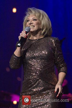 Shots of English singer and actress Elaine Paige OBE performing live in concert at the Glasgow Royal Concert Hall at...