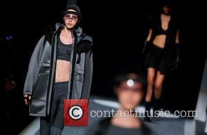 Model - Photographs from the runway at Alexander Wang's launch of his X H&M collection held at Fort Washington Avenue...