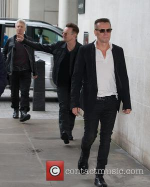 Adam Clayton, Larry Mullen, Jr., Bono and U2 - Celebrities at BBC Radio 1 at BBC Portland Place - London,...