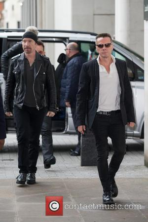 The Edge, Larry Mullen, Jr. and U2