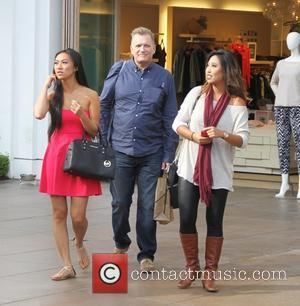Drew Carey goes shopping at The Grove with two female companions
