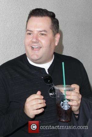 Ross Mathews departs from Los Angeles International Airport (LAX) with Starbucks in hand