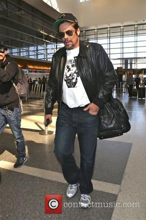 Benicio Del Toro departs from Los Angeles International Airport (LAX)