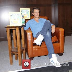 Josh Duhamel reads and signs the children's book 'Bunny Cakes' at Barnes & Noble as a Jumpstart 'Read For the...