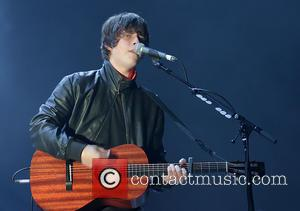 Photographs of the English singer songwriter, Jake Bugg as he gave a live performance at the Liverpool Echo Arena