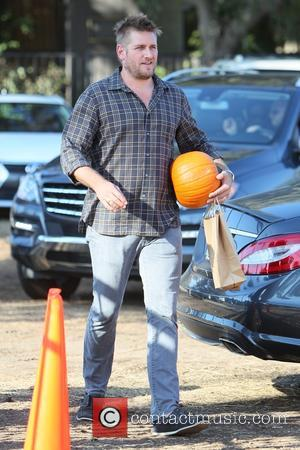 Aussie celebrity chef, Curtis Stone spotted with his wife and star of Beverly Hills 90210, Lindsay Price as they took...