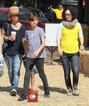 Sara Gilbert, Linda Perry and Levi Hank Gilbert-Adler - A pregnant Sara Gilbert and partner Linda Perry spend time as...