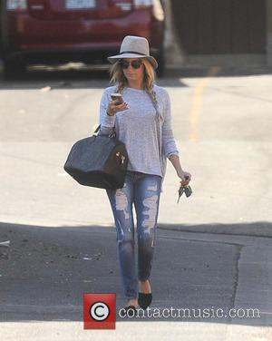 Ashley Tisdale wears a fedora hat to lunch