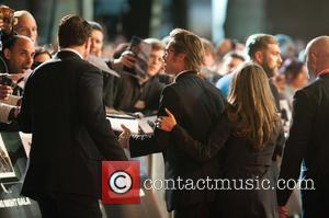 Photographs from the red carpet at the premiere of 'Fury' at the 58th British Film Institute London Film Festival