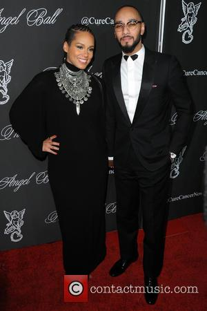 Alicia Keys and Swizz Beatz - Gabrielle's Angel Foundation Hosts Angel Ball 2014 - Red Carpet Arrivals - Manhattan, New...
