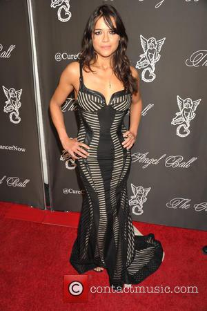 Michelle Rodriguez - A variety of celebs were photographed on the red carpet at the Angel Ball 2014 Held at...