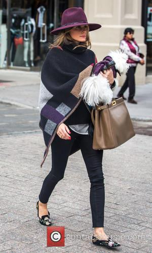 Olivia Palermo and Mr. Butler - Olivia Palermo, looking stylish wearing a hat and a poncho, running errands in Brooklyn...