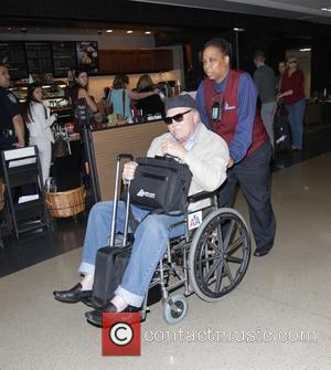 Stacy Keach - Veteran actor Stacy Keach arrives at Los Angeles International Airport (LAX) in a wheel chair - Los...
