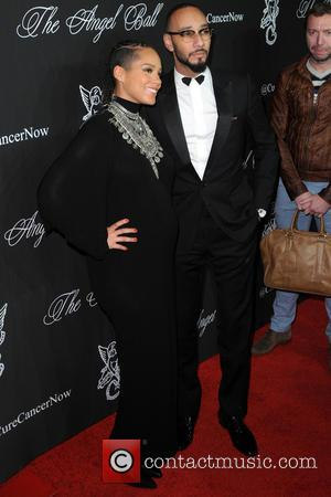Alicia Keys and Swizz Beatz - A variety of celebrities were photographed on the red carpet as Gabrielle's Angel Foundation...