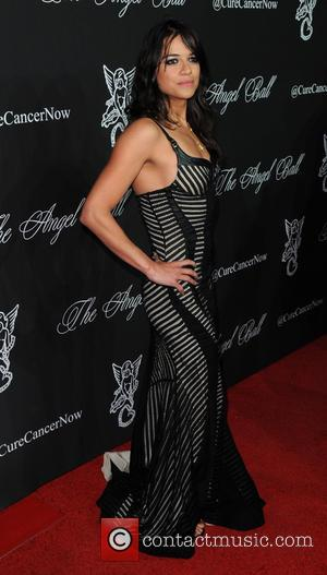 Michelle Rodriguez - A variety of celebrities were photographed on the red carpet as Gabrielle's Angel Foundation Hosted the Angel...