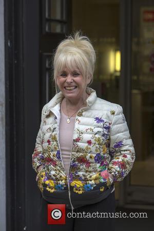 Barbara Windsor - Barbara Windsor arriving at BBC Radio 2 studios in a floral padded jacket - London, United Kingdom...