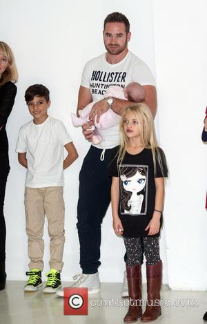 Kieran Hayler, Junior, Jett and Princess Tiaamii - Katie Price launches her new book 'Make My Wish Come True' at...