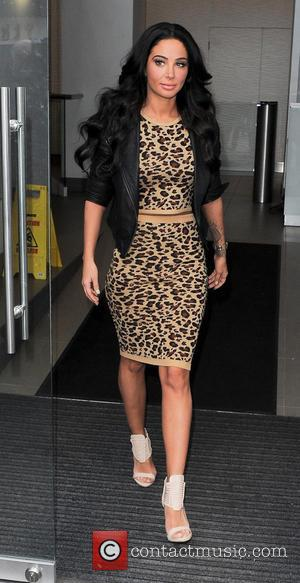 Tulisa Contostavlos - Tulisa Contostavlos at Capital FM, wearing a leopard print crop top and matching skirt. - London, United...
