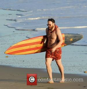 Seth Rogen - Actor Seth Rogen is lock and loaded on the beach and ready to surf for the new...