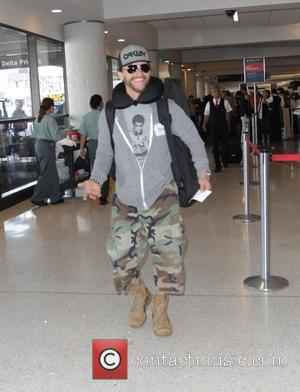 Clifton Collins Jr. - Pacific Rim star, Clifton Collins Jr. departs Los Angeles International Airport (LAX) in camouflage trousers -...