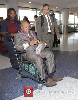 Quincy Jones - Quincy Jones departs Los Angeles International Airport (LAX) in a wheelchair - Los Angeles, California, United States...