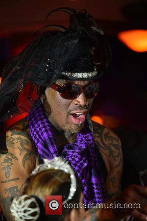 Dennis Rodman - Carmen Electra hosts Fright Night by Berman and Berman Law held at the Blue Martini - Boca...