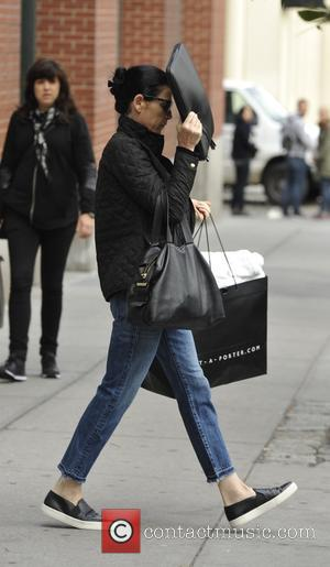 Julianna Margulies - A camera shy Julianna Margulies attempts to hide her face while out in New York - Manhattan,...