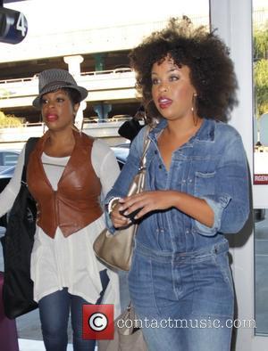 Niecy Nash and Kellee Stewart - Niecy Nash and Kellee Stewart arrive at Los Angeles International Airport (LAX) both carrying...