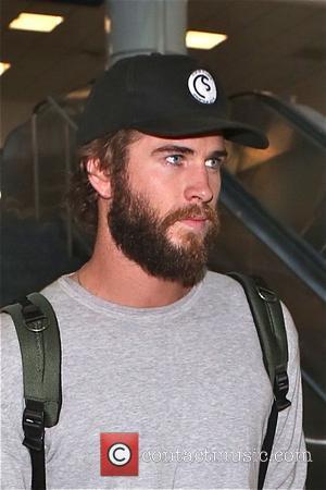 Liam Hemsworth - Liam Hemsworth arrives at Los Angeles International Airport (LAX) sporting a beard - Los Angeles, California, United...