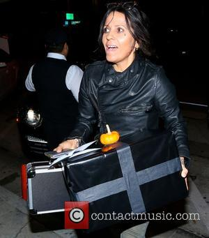 Linda Perry - Lead singer Linda Perry of 4 Non Blondes arrives at Craig's Restaurant in West Hollywood carrying birthday...