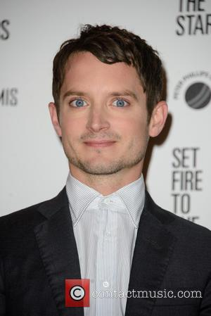 Elijah Wood - Stars were photographed as they attended the UK premiere of 'Set Fire to the Stars' The premiere...