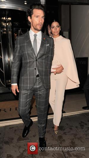 Matthew McConaughey and Camila Alves - Matthew McConaughey wearing a checked grey suit and wife Camila Alves in a peach...