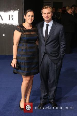 Christopher Nolan and Emma Thomas - Photographs of the Hollywood stars as they attended the UK Premiere of Sci-Fi movie...