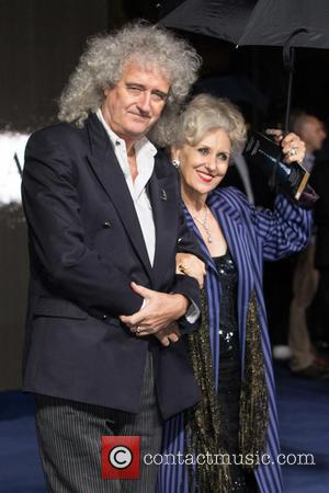 Anita Dobson and Brian May - Photogrpahs of the Hollywood stars as they attended the UK Premiere of Sci-Fi movie...