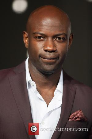 David Gyasi - Photographs of the Hollywood stars as they attended the UK Premiere of Sci-Fi movie 'Interstellar' The premiere...