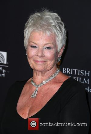 Judi Dench - A variety of stars were photographed on the red carpet for the 2014 British Aacademy of Film...