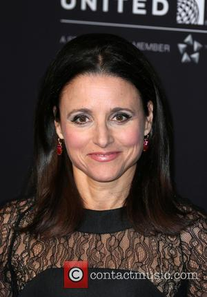 Julia Louis-Dreyfus - A variety of stars were photographed on the red carpet for the 2014 British Aacademy of Film...