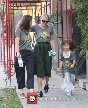 Busy Philipps - Cougar Town star Busy Philipps out in West Hollywood with family all wearing matching grey t-shirt portraying...