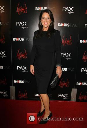 Cathy Schulman - Photographs of the stars on the red carpet at the Los Angeles premiere of 'Horns' starring Danierl...