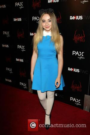 Sabrina Carpenter - Photographs of the stars on the red carpet at the Los Angeles premiere of 'Horns' starring Danierl...