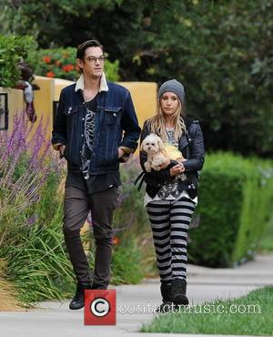 Ashley Tisdale and Christopher French - Ashley Tisdale and her husband Christopher French wear matching skeleton t-shirts on a walk...