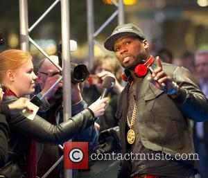 50 Cent and Curtis James Jackson III - 50 Cent promoting his new SMS Audio head phones in the Heineken...