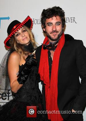 Dawn Olivieri and Guest - The worlds leading organisation for children UNICEF presented the Next Generation's 2nd Annual UNICEF Masquerade...
