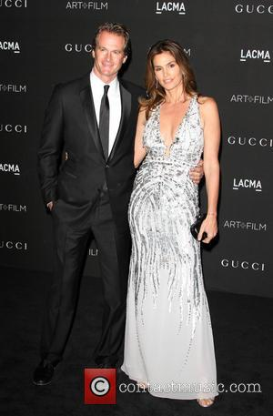 Rande Gerber and Cindy Crawford - A variety of celebrities were photographed as they arrived at the 2014 LACMA Art+Film...