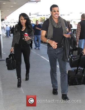 Lionel Richie - Lionel Richie with his daughter depart from Los Angeles International Airport (LAX) - Los Angeles, California, United...