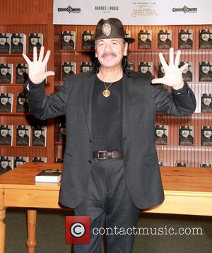 Carlos Santana - Carlos Santana's book signing celebrating the release of his memoir 'The Universal Tone' at Barnes & Noble...