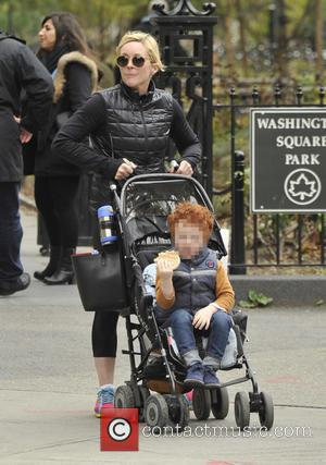 Jane Krakowski and Bennett Robert Godley - Jane Krakowski and her son Bennett out for a stroll near Washington Square...