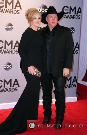 Trisha Yearwood and Garth Brooks - 48th Annual CMA awards at the Bridgestone Arena - Red carpet at Bridgestone Arena...
