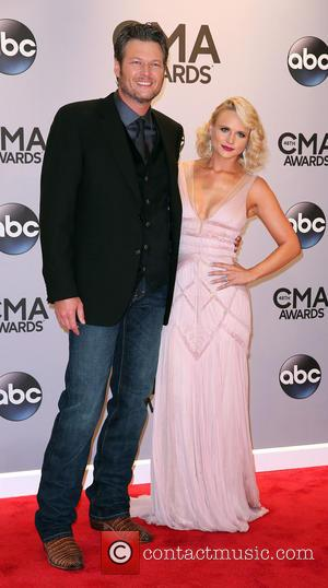 Blake Shelton and Miranda Lambert - Shots of a variety of stars as they took to the red carpet for...